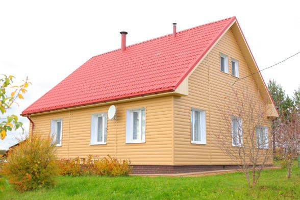 Обшитый каркасный дом сайдингом своими руками